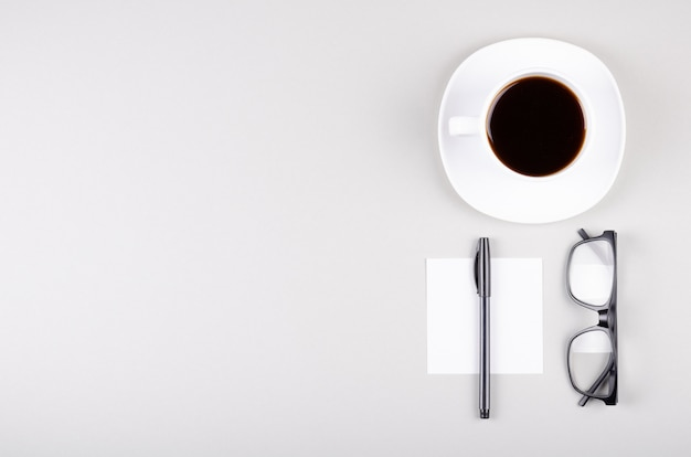 Coffee cup composition on gray background. flat lay.