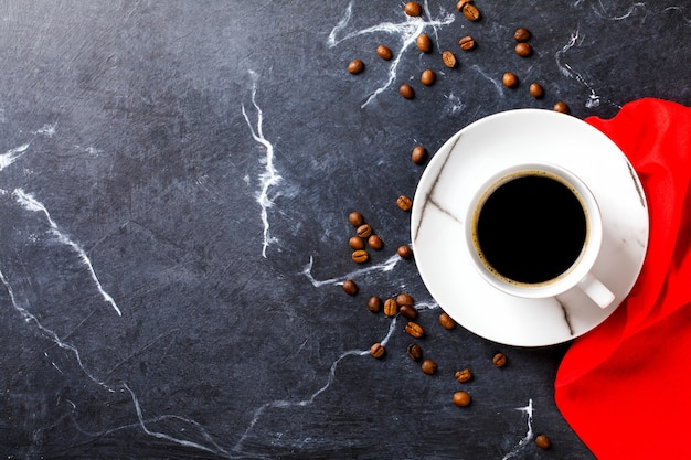 Coffee cup on a dark marble