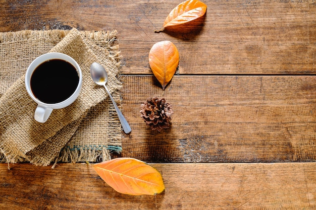 Coffee cup and dried leaves background