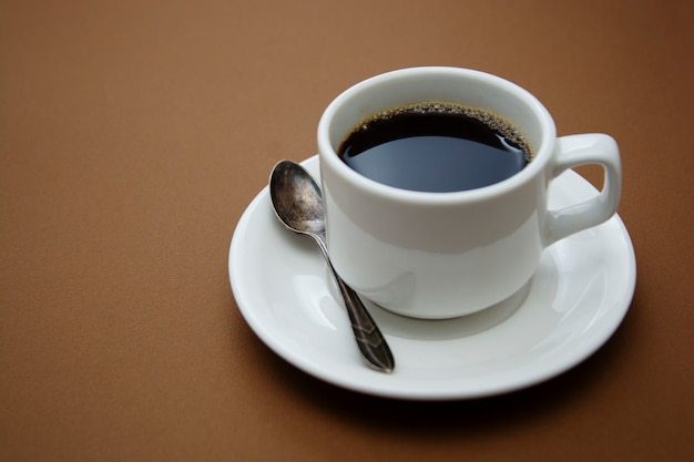 Coffee cup isolated on brown table. coffee drink with copy space.