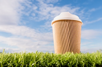 Coffee cup made from paper on grass