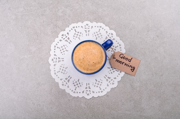 Coffee cup and note good morning.
