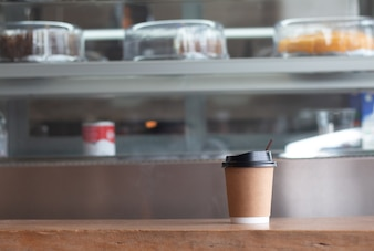 Coffee Cup of hot draink  on wooden desk in coffee's shop