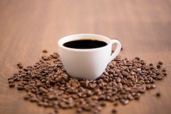 Coffee cup on beans