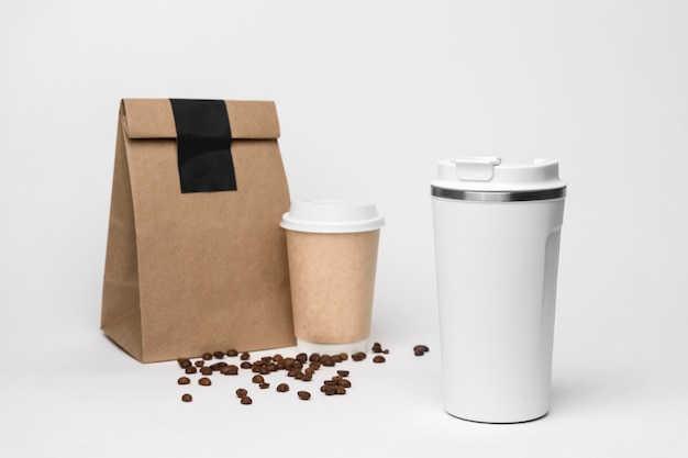 Coffee cup and paper bag arrangement