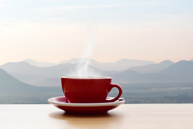 Coffee cup red with morning sunshine mountain view