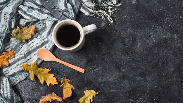 Coffee cup and scarf copy space