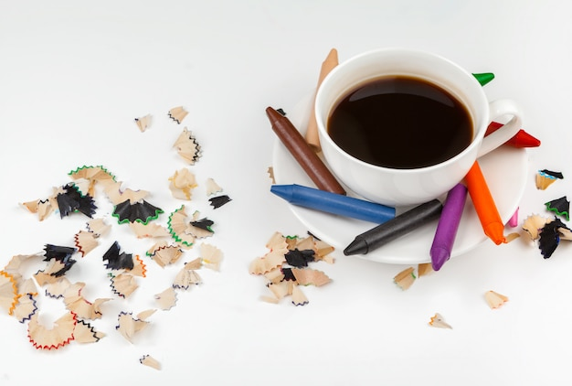 Coffee cup and sharped pencils with pencil shaving
