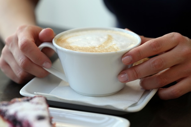 Coffee cup on the table Free Photo