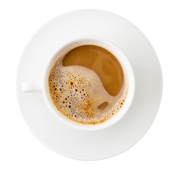 白い背景の上のコーヒーカップの上面図。孤立