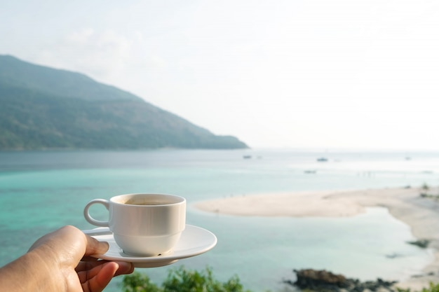Coffee cup with beautiful beach in the summer time. concept travel, holiday and vacation. nature landscape at lipe island in thailand