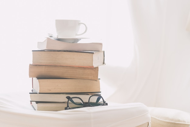 Coffee cup with book and eyeglasses