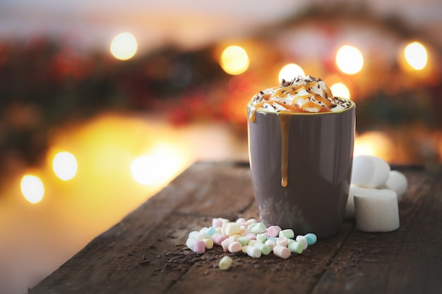Coffee cup with caramel and whipped cream
