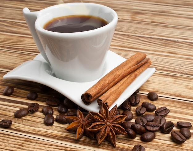 Coffee cup with cinnamon sticks and star anises