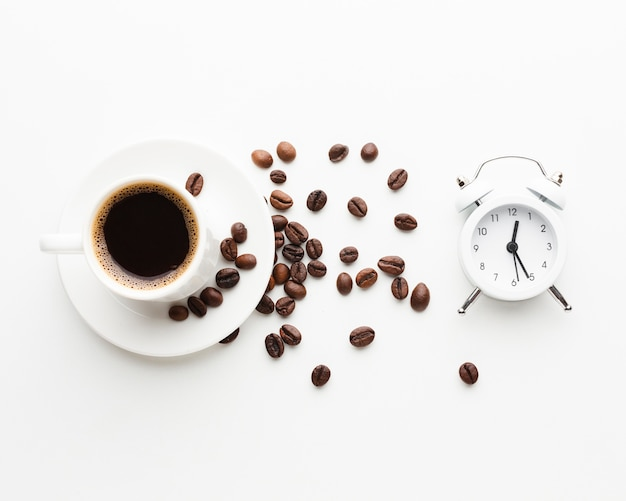 Coffee cup with clock on the table