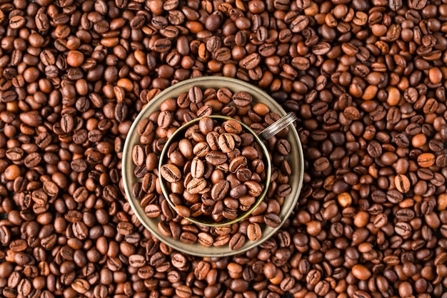 Coffee cup with coffee beans. top view