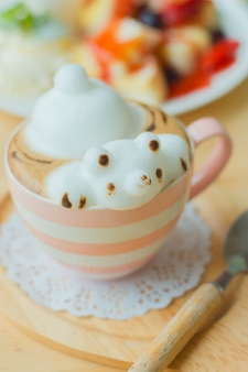 Coffee cup with coffee and bear shaped milk foam