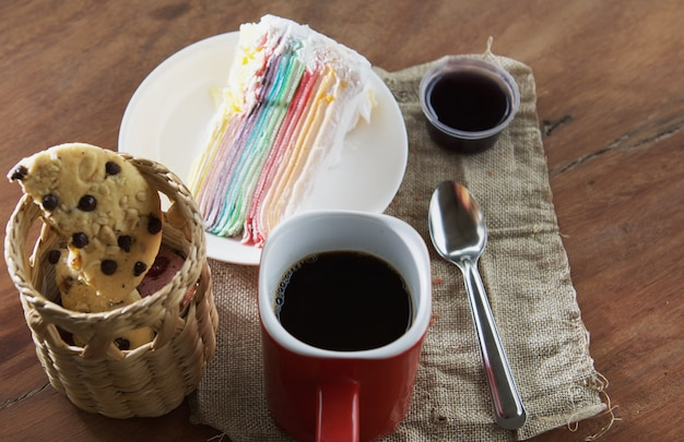 Coffee cup with cupcake and chocolate cookie on table