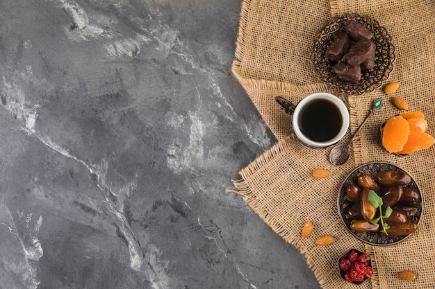 Coffee cup with dates fruit and almonds