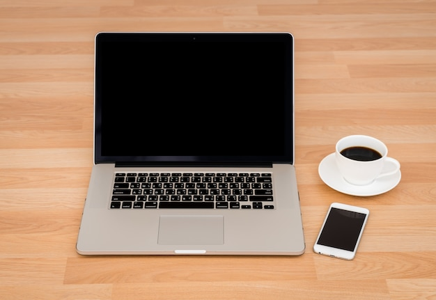Coffee cup with laptop and smartphone