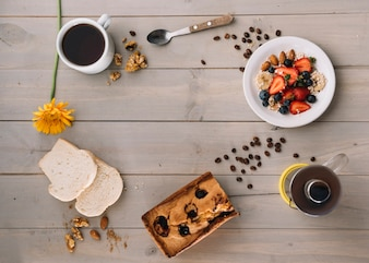 Coffee cup with oatmeal and toasts on table