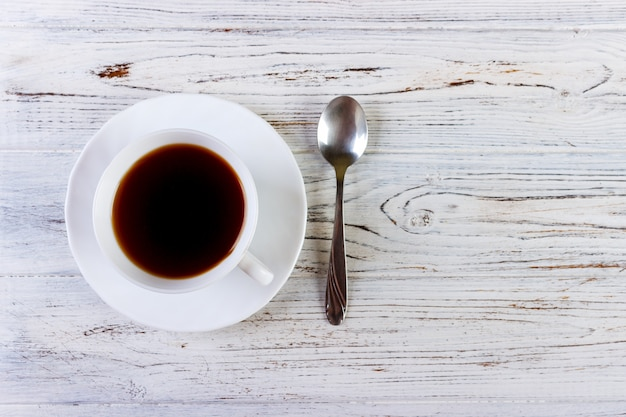 Coffee in a cup with spoon on a white background