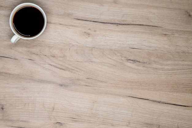 Coffee cup on wooden board