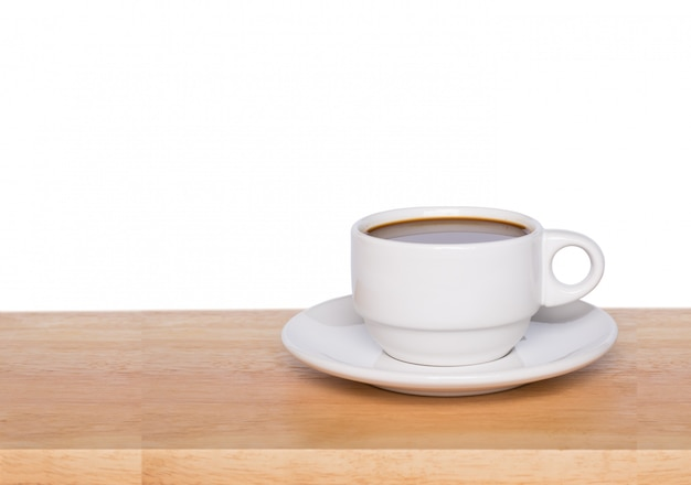 Coffee cup on wooden table, isolated on white