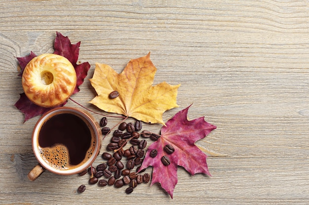 Coffee, cupcake and autumn leaves
