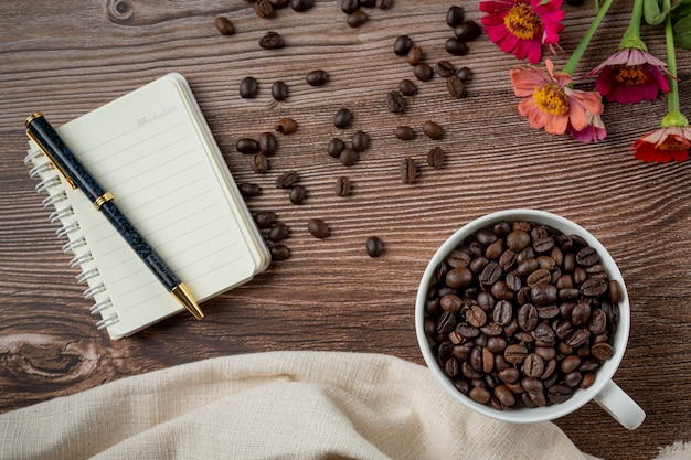 Coffee cups and coffee beans on the table, international day of coffee concept.
