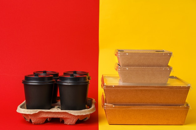 Coffee cups and takeaway food package. takeout meal concept