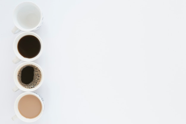 Coffee cups on white table with copy space