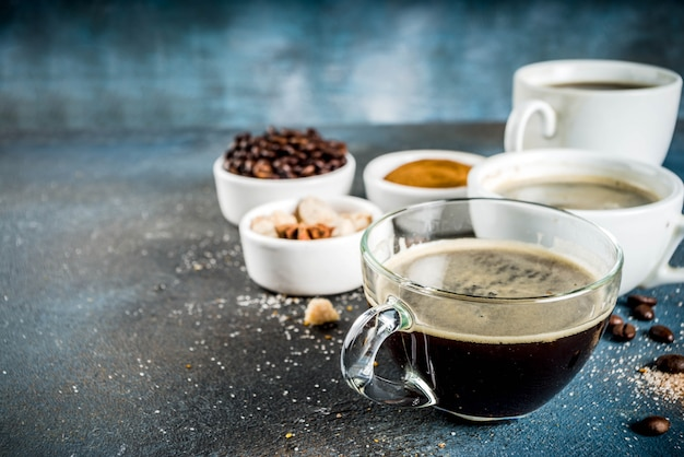 Coffee cups with beans and ground coffee
