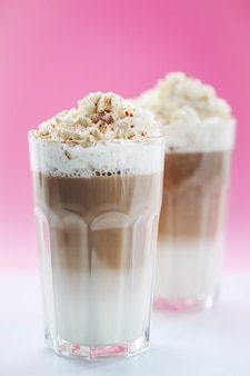Coffee cups with caramel and whipped cream