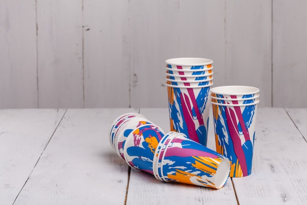 Coffee cups on wooden table for site header
