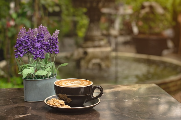 Coffee and dessert on the garden table.