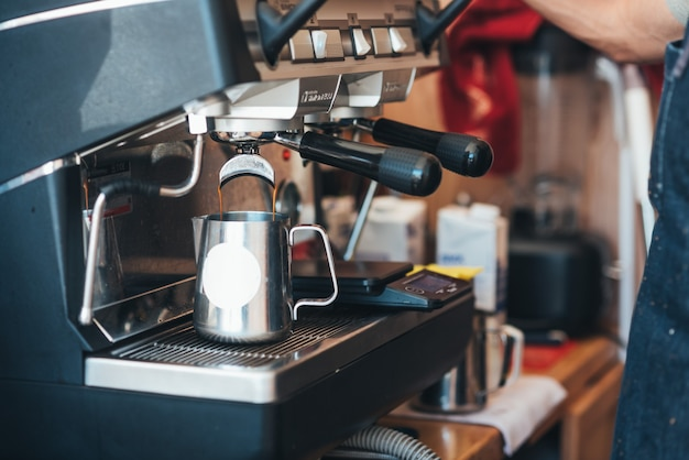 Coffee in a disposable cup with a coffee machine