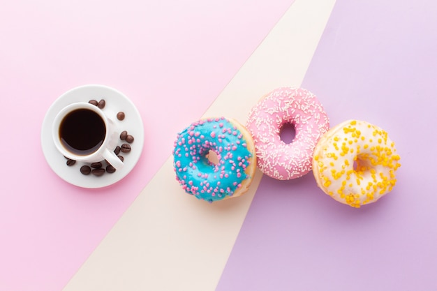 Coffee next to donut set top view