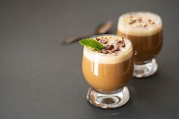 Coffee drink with ice cream, espresso. affogato, summer refreshing drink in glass.