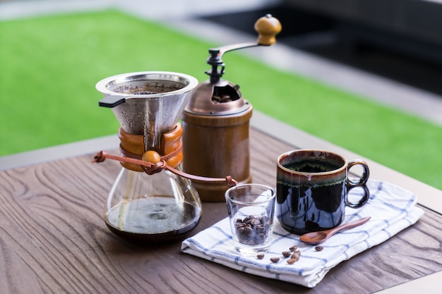 Coffee drip equipment set on wooden table.