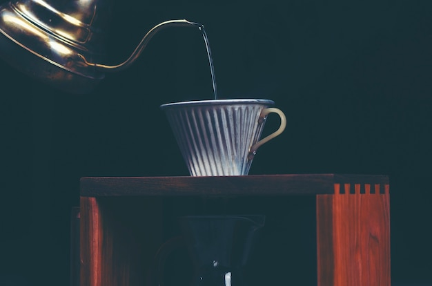 Coffee dripping process, vintage filter image