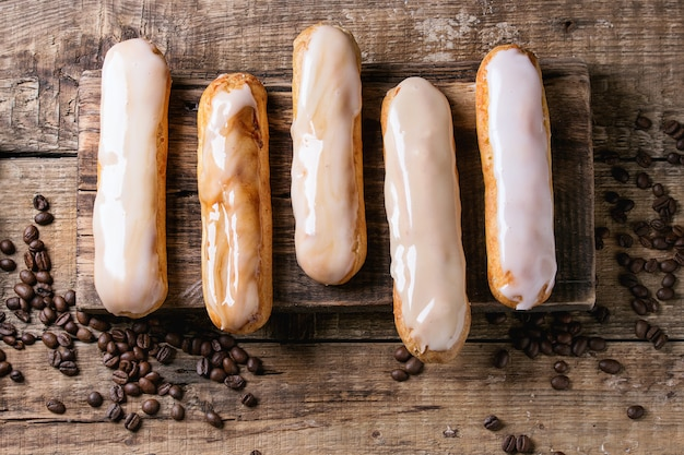 Coffee eclairs over wood