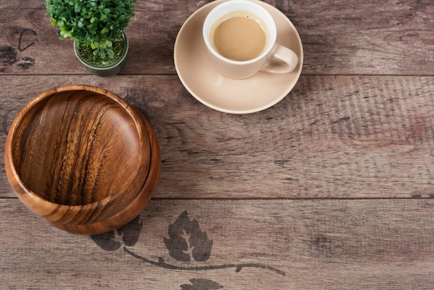 Coffee espresso, bonsai tree and bamboo bowls on wooden table