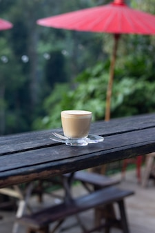 Coffee espresso on wood table nature background in garden