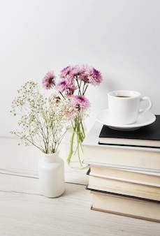 Coffee and flowers on plain background