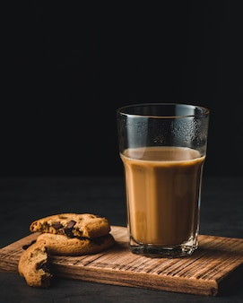 Coffee glass cup and cookies with chocolate