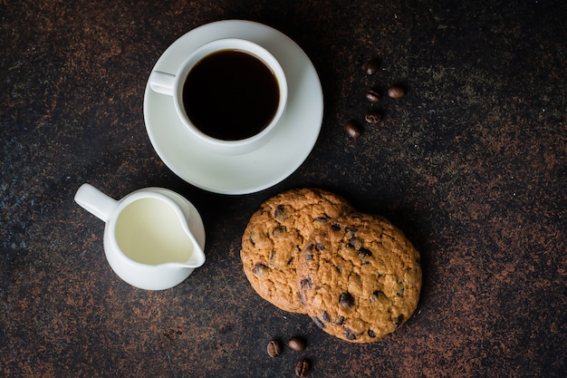 Coffee glass and milk with chocolate chip cookie