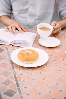 Coffee, a good book and bread for a good morning in cafeteria