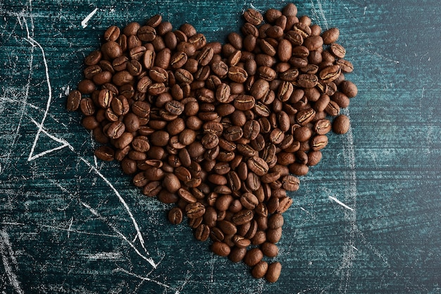 Coffee grains in heart shape.