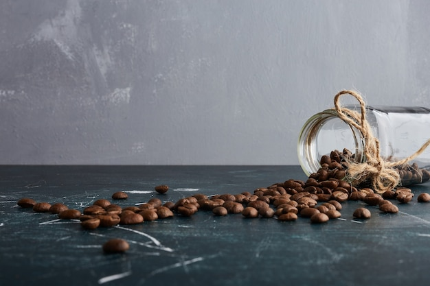 Coffee grains out of a glass jar.